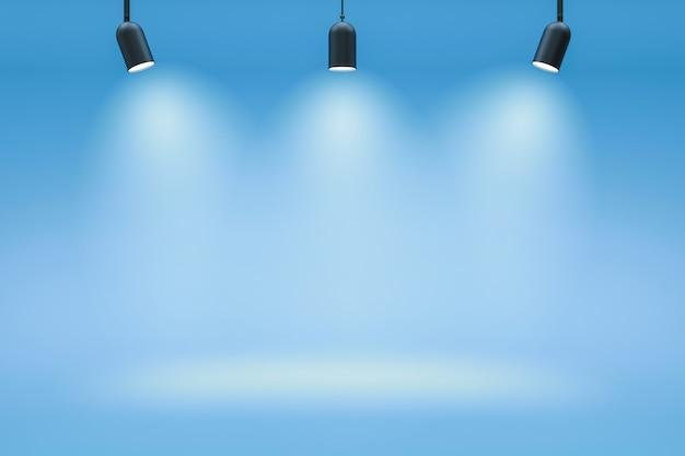 Leere fotostudio-hintergründe und scheinwerfer auf blauem raumhintergrund mit zeigender szene. farbverlauf blau oder leerer raum. 3d-rendering.