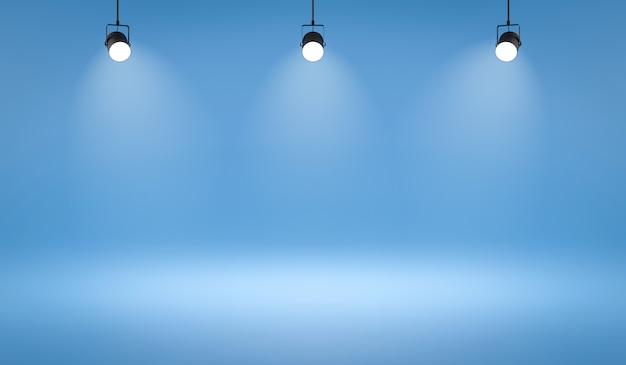 Leere fotostudio-hintergründe und scheinwerfer auf blauem raumhintergrund mit zeigender szene.