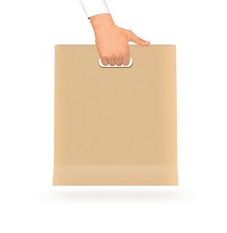 Leere gelbe papiertüte, die in der hand hält. kunststoff leer pa
