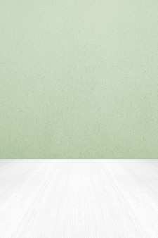 Leere grüne zementwand und weißer holzbodenhintergrund für produktanzeigemontage