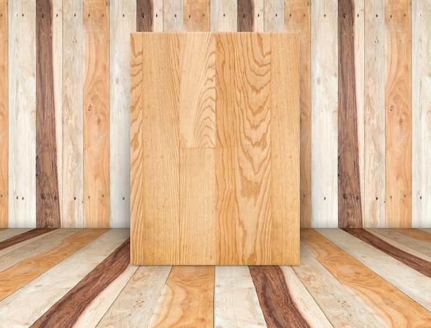 Leere hölzerne leinwand am hölzernen plankenzimmer, verspotten herauf schablone für das hinzufügen ihres inhalts oder designs