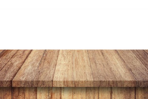 Leere hölzerne tabelle auf weißem hintergrund des isolats und anzeigenmontage mit kopienraum für produkt.