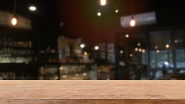 Leere holztischplatte und unscharfer café- und restaurantinnenhintergrund.