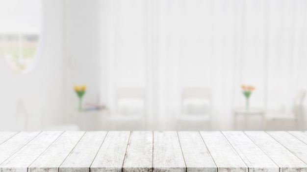 Leere holztischplatte und verschwommener hintergrund für cafés und restaurants - können zur anzeige oder montage ihrer produkte verwendet werden.