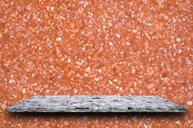 Leere oberseite der polierterrazzosteinregale auf terrazzohintergrund