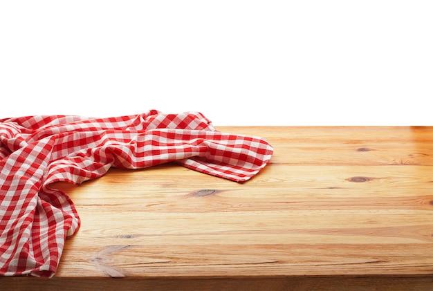 Leere rote tischdecke auf holztischoberansicht