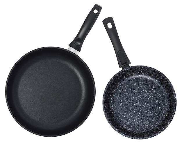 Leere schwarze pfanne isoliert. satz von zwei pfannen.
