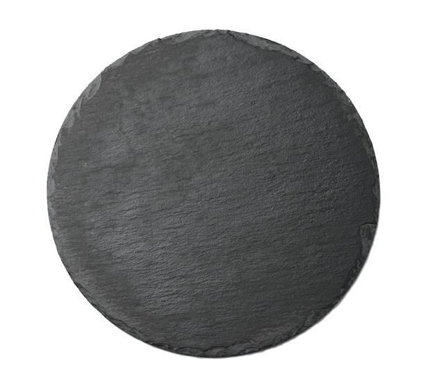Leere schwarze runde graphitplatte zum servieren von geschirr isoliert auf weißem hintergrund, ansicht von oben