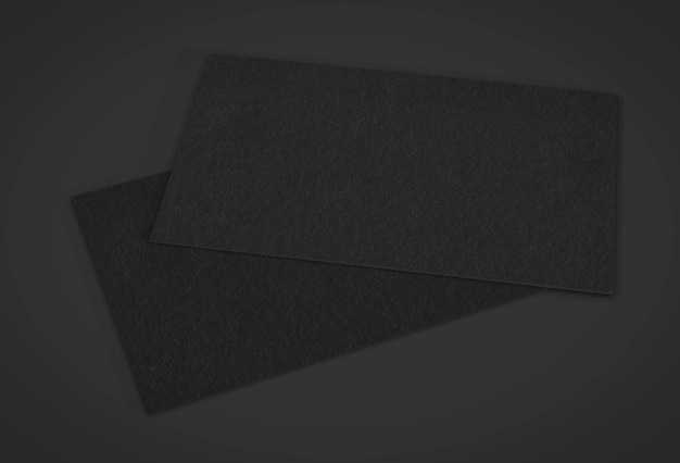 Leere schwarze visitenkarten auf schwarz. 3d-rendering.