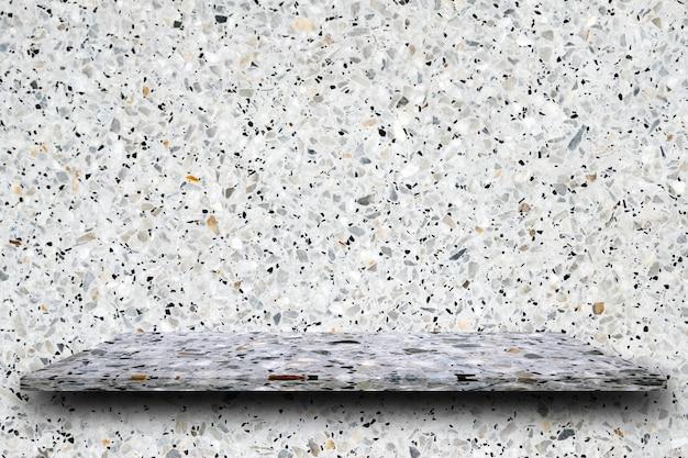 Leere spitze von polier-terrazzo-steinregalen auf terrazzo-hintergrund