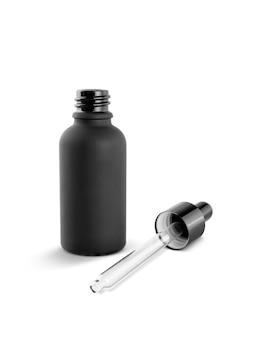 Leere verpackung schwarzglas tropfer serumflasche isoliert auf weiß
