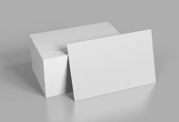 Leere visitenkarten auf grau. 3d-rendering.