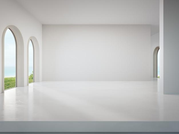 Leere wand auf weißem betonboden des hellen wohnzimmers im modernen strandhaus oder im luxushotel