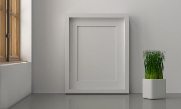 Leere weiße farbbilderrahmenschablone für platzbild oder -text innerhalb und baumdekoration auf tabelle nahe den fenstern.