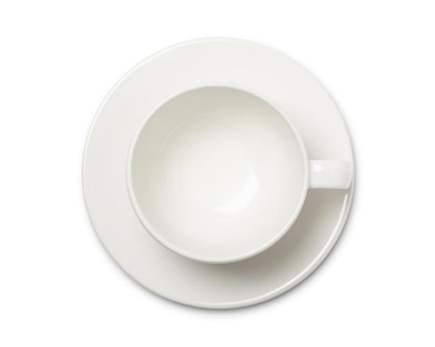 Leere weiße kaffeetasse oder teetasse draufsicht auf weißen raum. mit beschneidungspfad.