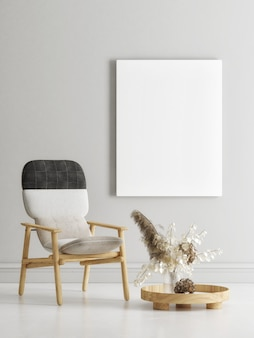 Leere weiße leinwand auf dem wohnzimmerkonzept der grauen wand mit heimtextilien