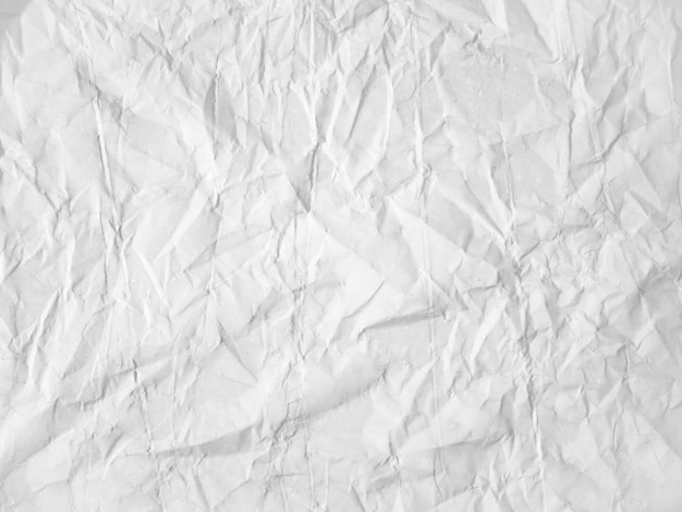 Leere weiße papierstruktur an der wand geklebt