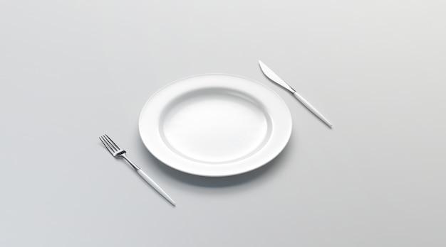 Leere weiße platte mit gabel und messer, seitenansicht