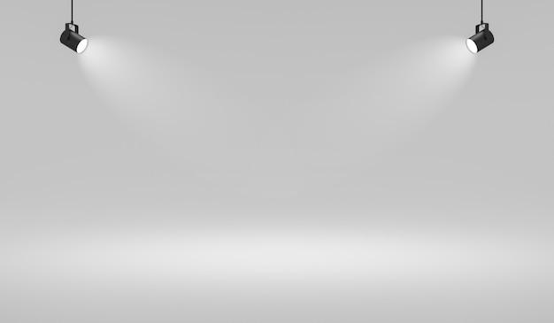 Leere weiße studiohintergründe und scheinwerfer auf unterhaltungsraumhintergrund mit zeigender szene.