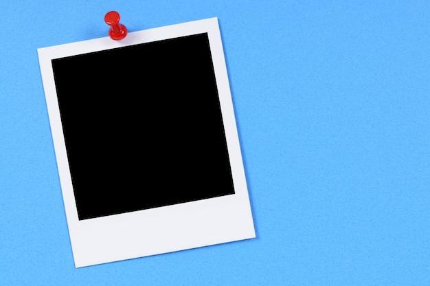 Leerer fotodruck mit blauem hintergrund