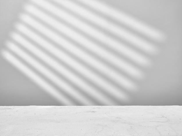 Leerer grauer hintergrund mit lichtern und schatten