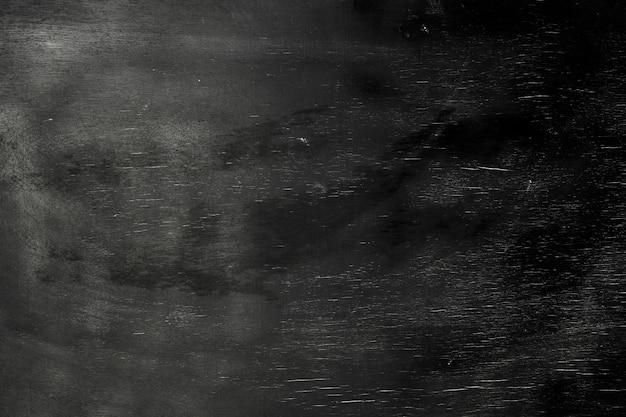 Leerer hölzerner schwarzer kreideschultafelhintergrund