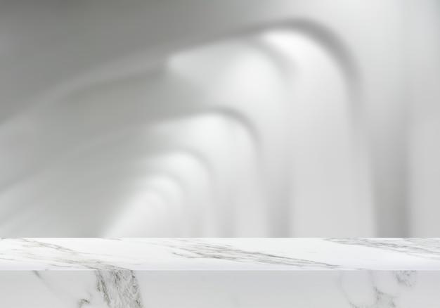 Leerer marmortisch an der galeriearchitekturhintergrundproduktkulisse