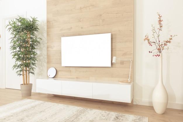 Leerer moderner flachbildschirm fernsehapparat, der an der wand im wohnzimmer hängt