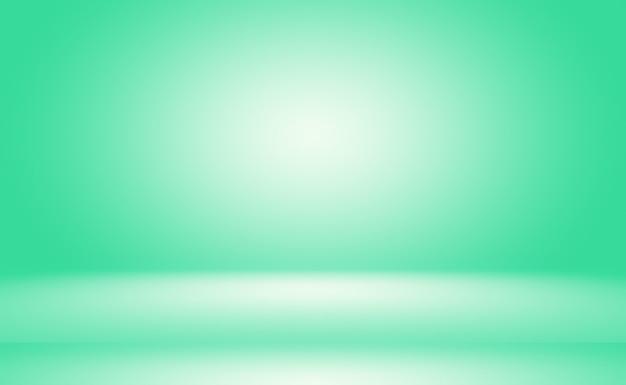 Leerer raum des abstrakten hintergrunds des grünen farbverlaufs mit raum für ihren text und bild Premium Fotos