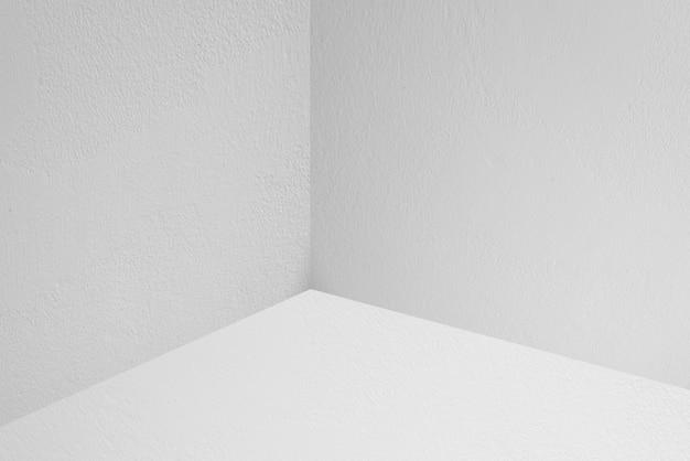 Leerer raum mit betonmauer- und bodenhintergründen, gebrauch für anzeigeprodukt