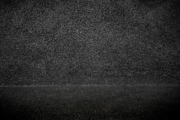 Leerer schwarzer beton mit grauer steindekorationsoberflächenbeschaffenheit und -hintergrund.