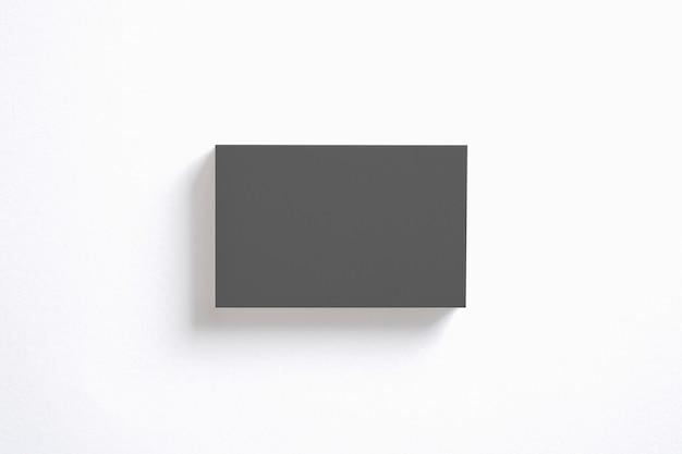 Leerer schwarzer visitenkartenstapel lokalisiert auf weiß. löschen sie die vorlage, um ihre präsentation zu präsentieren.