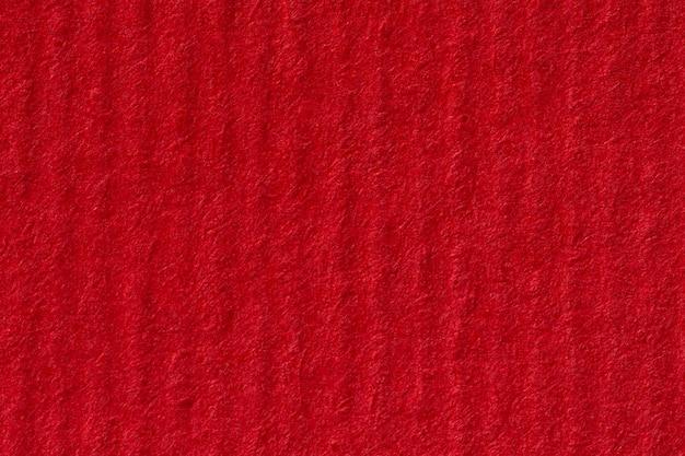 Leerer strukturierter roter papierhintergrund. hochauflösendes foto.