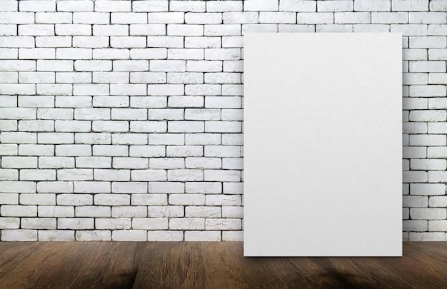 Leerer weißer bilderrahmen auf der alten backsteinmauer und der bretterbodenhintergrund