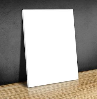 Leerer weißer plakatrahmen am bretterboden und an der schwarzen betonmauer