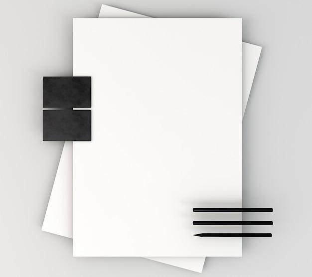 Leeres firmenbriefpapier und bleistifte
