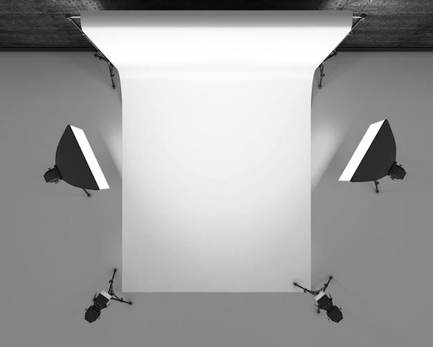 Leeres fotostudio mit beleuchtungsgeräten. studiobeleuchtung für fotoshootings. 3d-rendering.