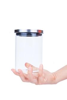 Leeres glasgefäß des handgriffs mit dem aluminiumdeckel lokalisiert auf weißem hintergrund