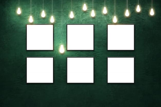 Leeres quadratisches weißes papierplakat im schwarzen rahmen an der grün gestrichenen gipswand. grungy interieur mit hängender glühbirne.