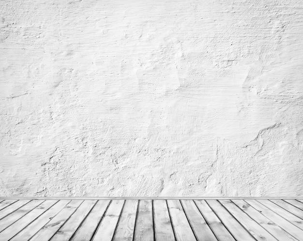 Leeres retro-zimmer mit betonwand und holzboden. nahansicht