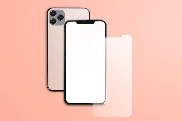 Leeres roségoldenes telefon auf pfirsichhintergrund