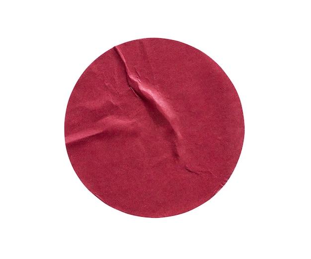 Leeres rotes rundes klebepapier-aufkleberetikett lokalisiert auf weißem hintergrund