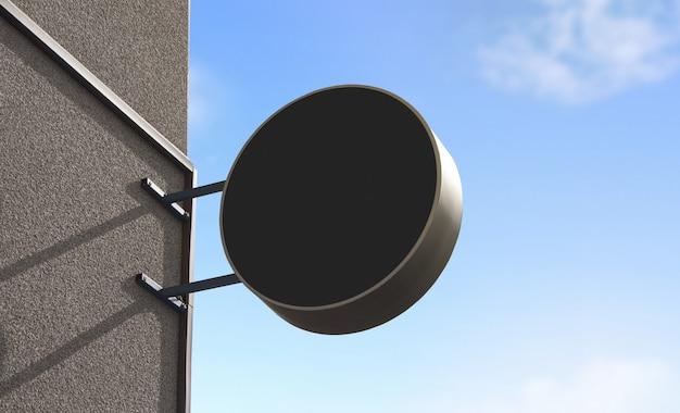Leeres schwarzes rundes beschilderungsmodell für den außenbereich an der wand montiert