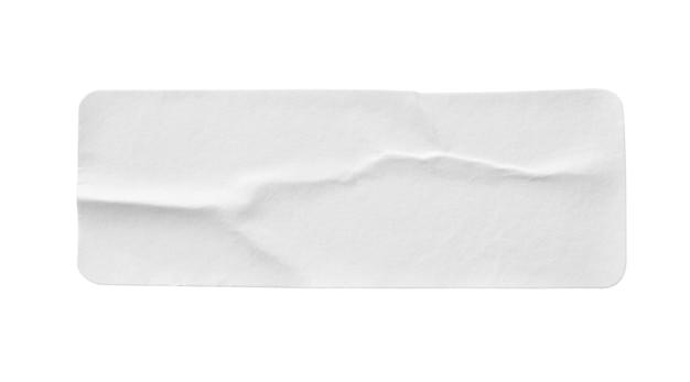 Leeres weißes papieraufkleberetikett lokalisiert auf weißem hintergrund