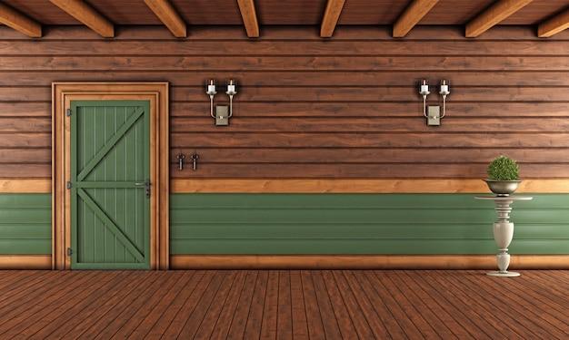 Leeres wohnzimmer eines holzhauses mit geschlossener tür