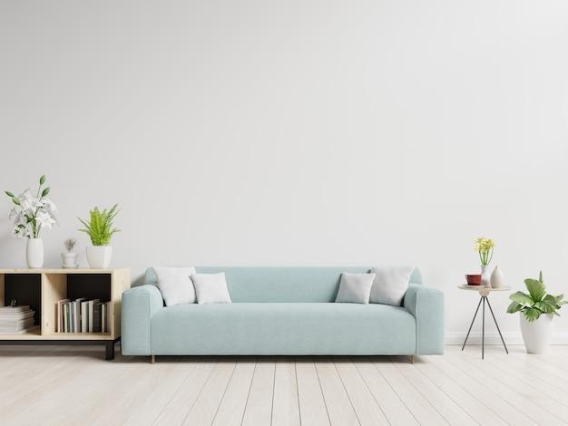 Leeres wohnzimmer mit blauem sofa, anlagen und tabelle auf leerem weißem wandhintergrund.