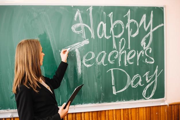 Lehrer an bord schreiben