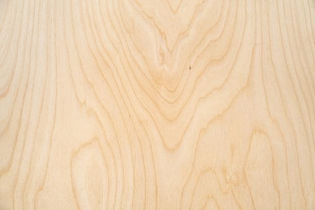 Leichter holzbeschaffenheitssperrholzhintergrund. rustikale tischansicht, flach gelegen.