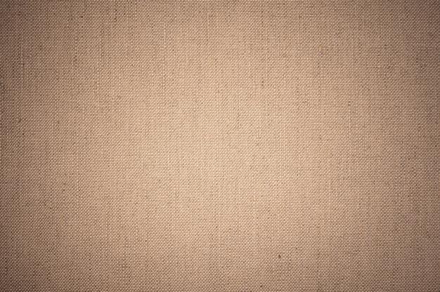 Leinwand stoff textur. hintergrundmuster der braunen sackleinenbeschaffenheit.