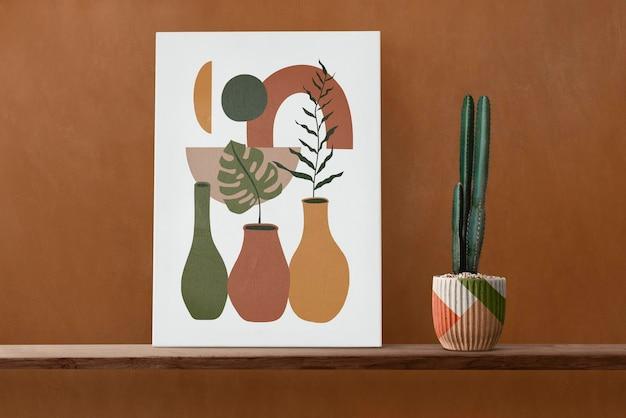 Leinwandbild auf einem holzregal mit kaktus